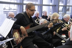 Chris N., electric bass, performing at Welcome Home Honor Flight performance on April 7, 2018, at ROC International Airport . Photo by Patricia Elliott.