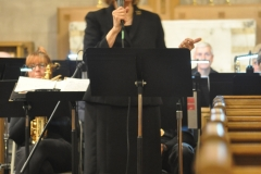 "Marcia Bornhurst Parkes, music director, speaking to audience during the ""Time for Lovin"" benefit concert at Asbury First United Methodist Church, September 26, 2019. Photo by Steven Lau."